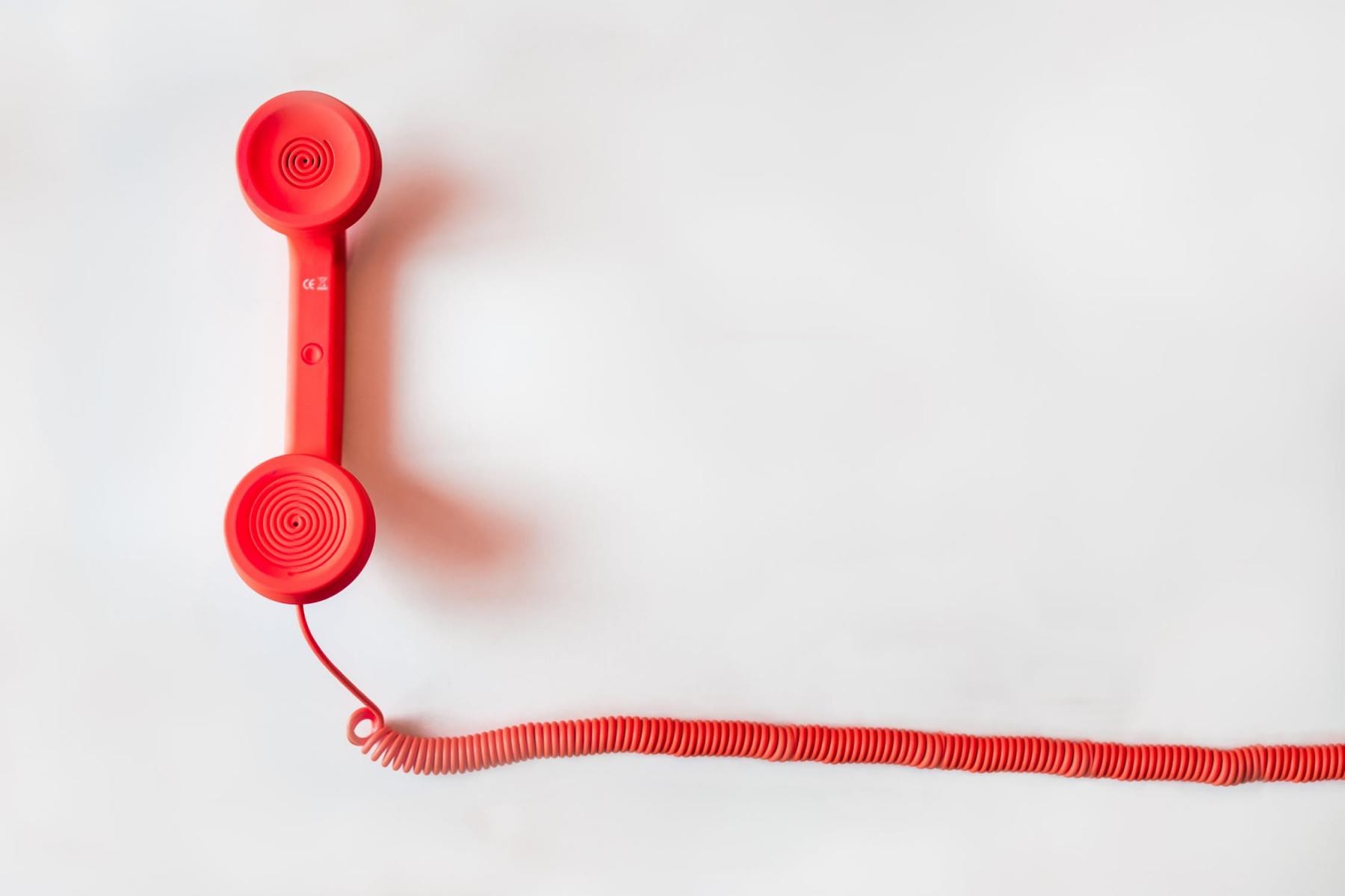 red phone on white background