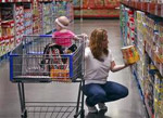 woman with a child grocery shopping