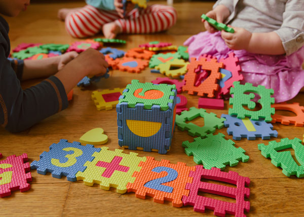 Children playing with number toys