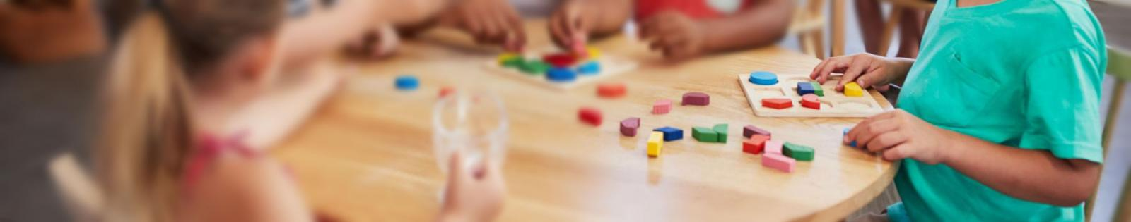 kids playing at table with blocks